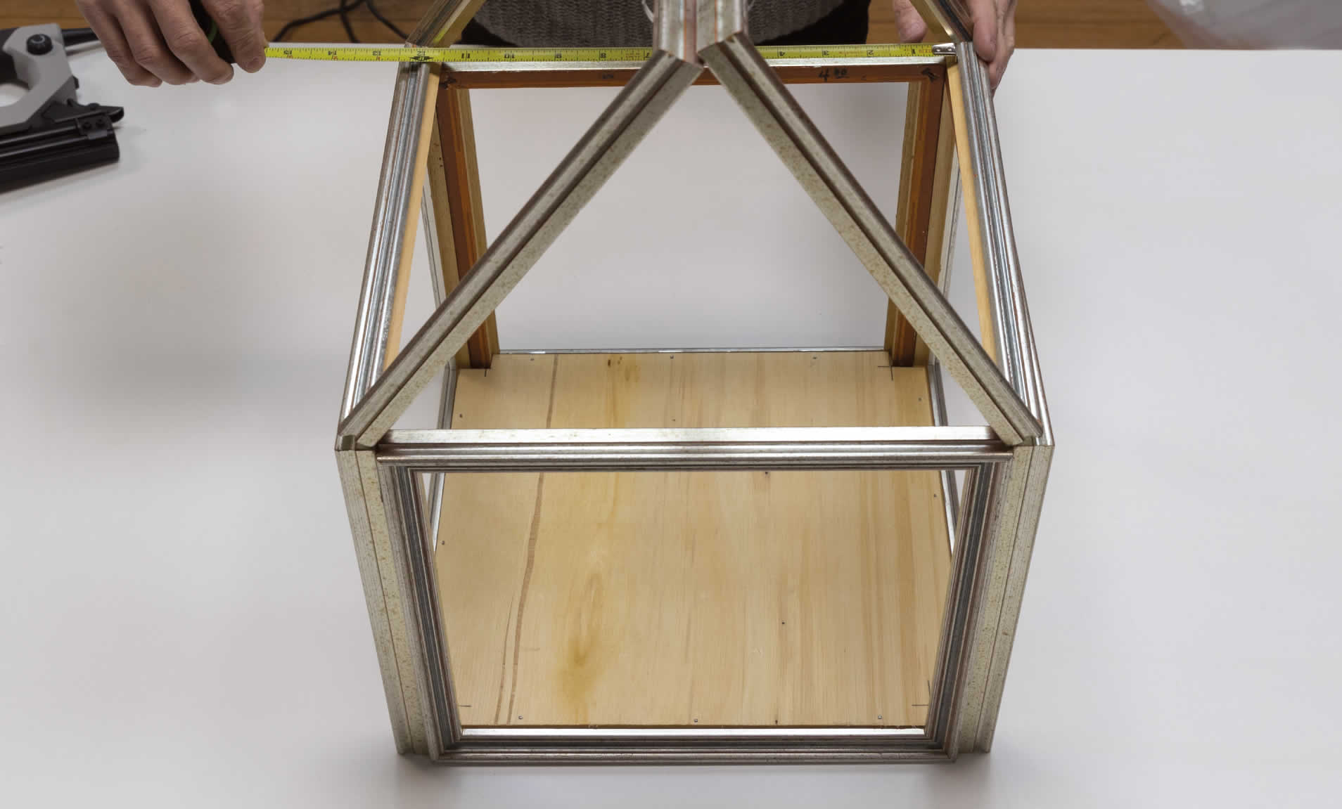Step 4b-mini indoor greenhouse-Set on top of the cube and measure the distance between the frames.