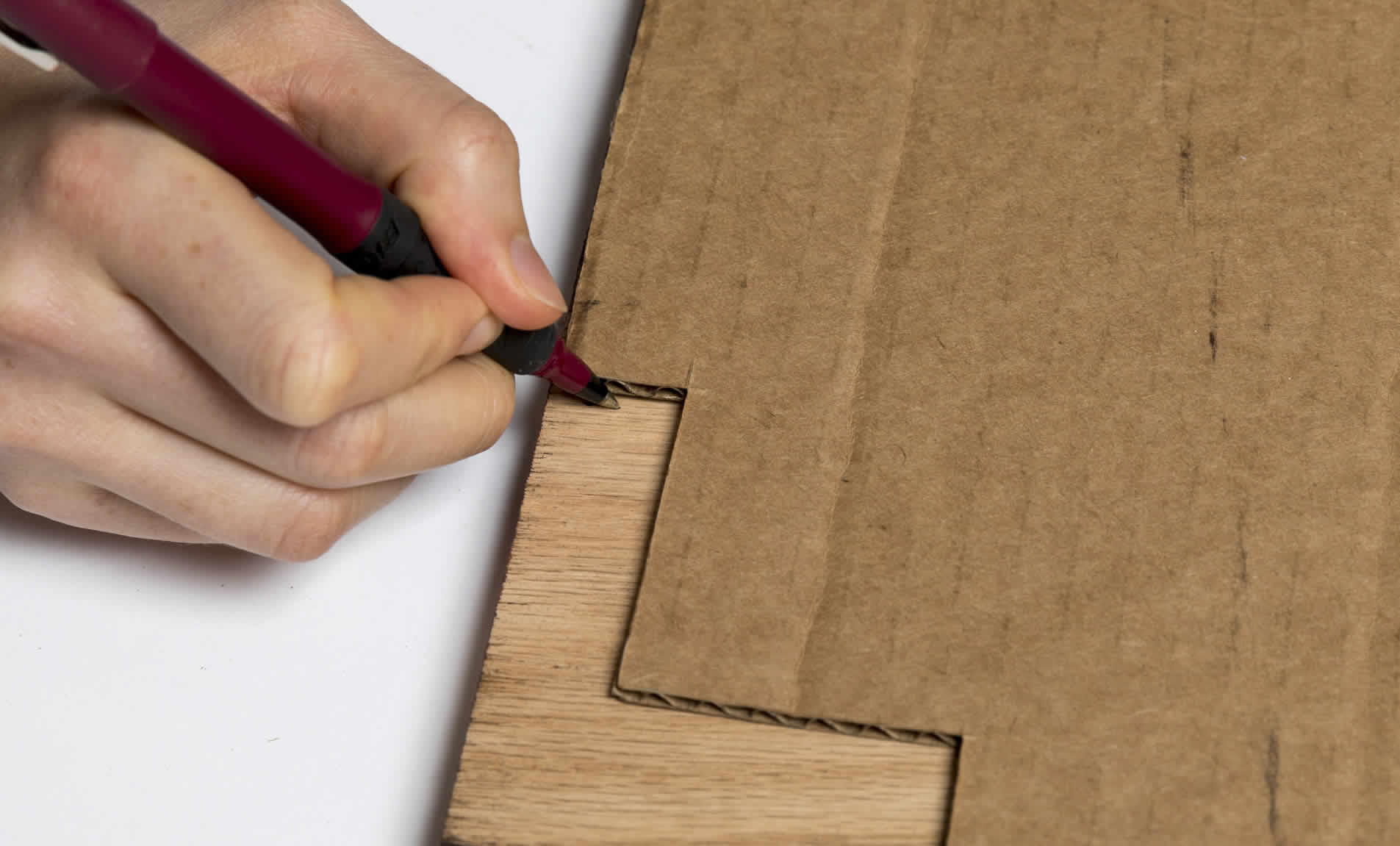 Pen marking wood to be cut