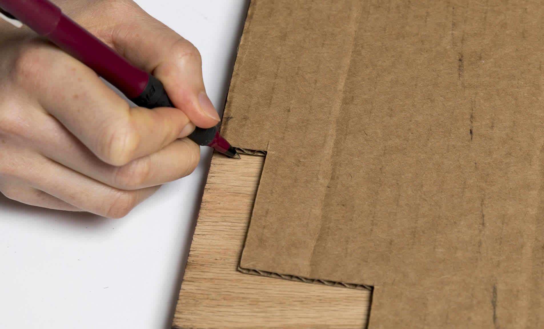 Pen marking wood to be cut