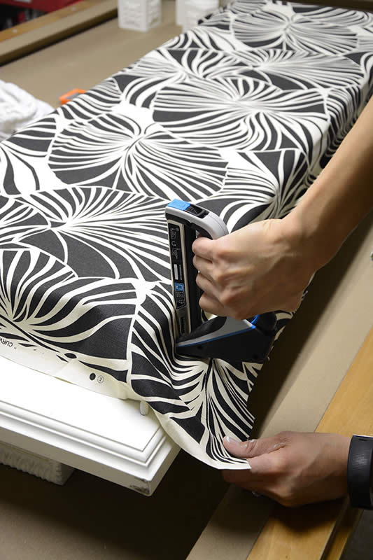 Serena Appiah of Thrift Diving uses Arrow Fastener's T50X TacMate heavy duty staple gun on the reupholstered bench