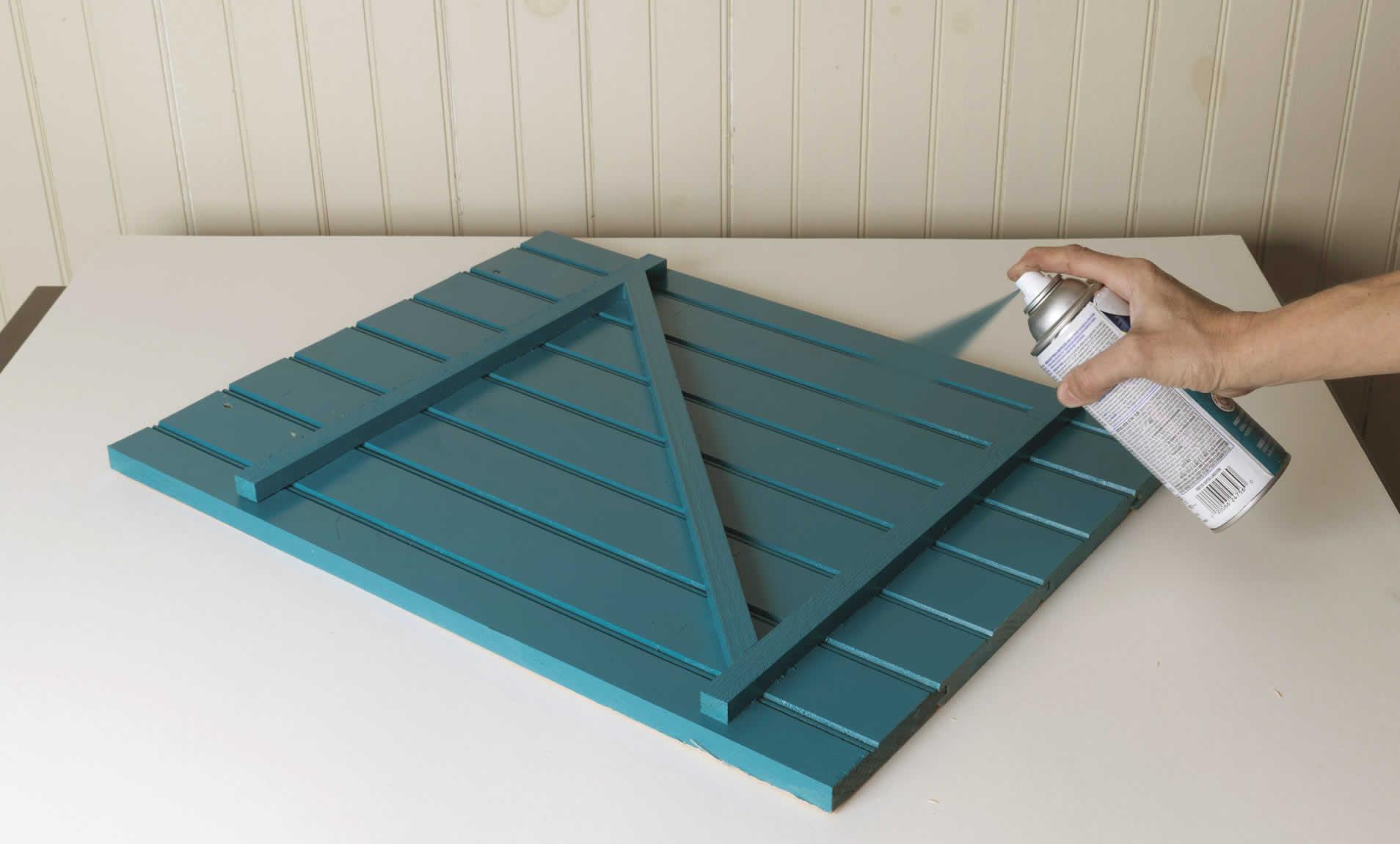 spray painting door for sliding barn door cabinet DIY project
