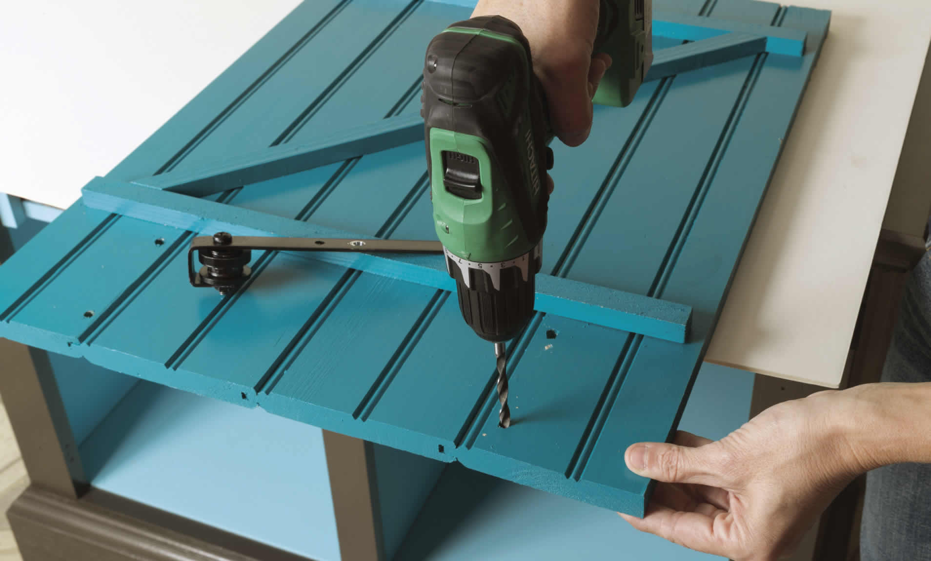 drilling holes for sliding barn door cabinet DIY project